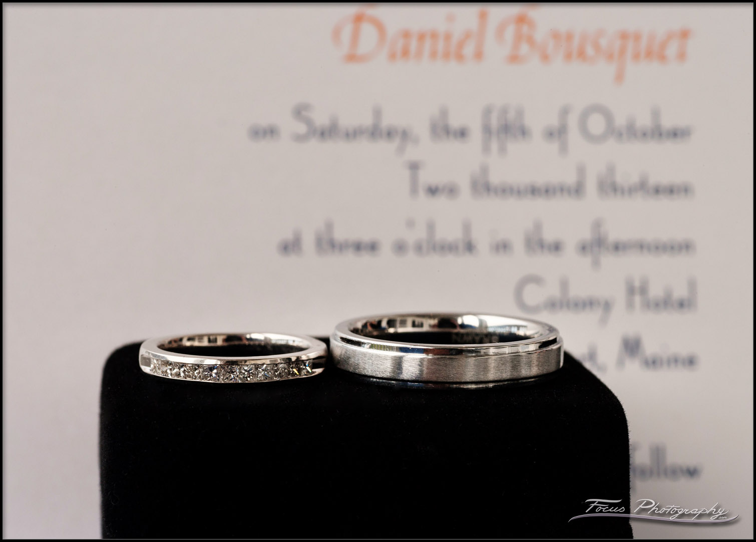 wedding bands in front of invite