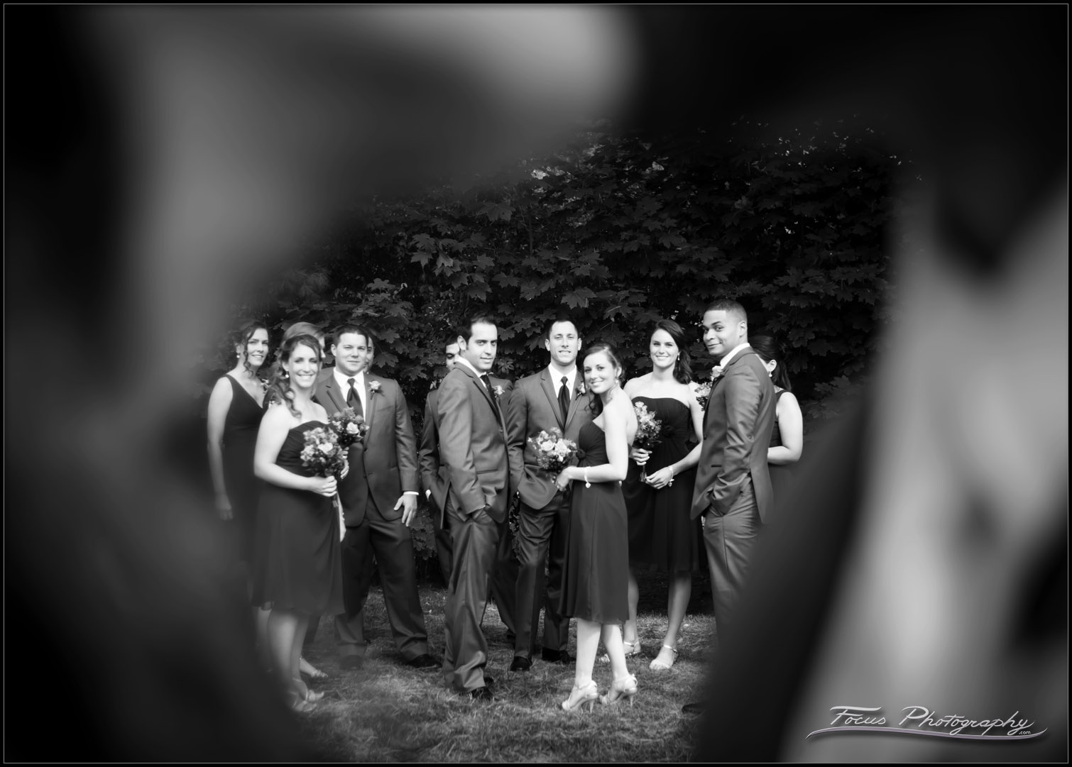 Wedding party viewed through kiss at Colony Hotel in Maine