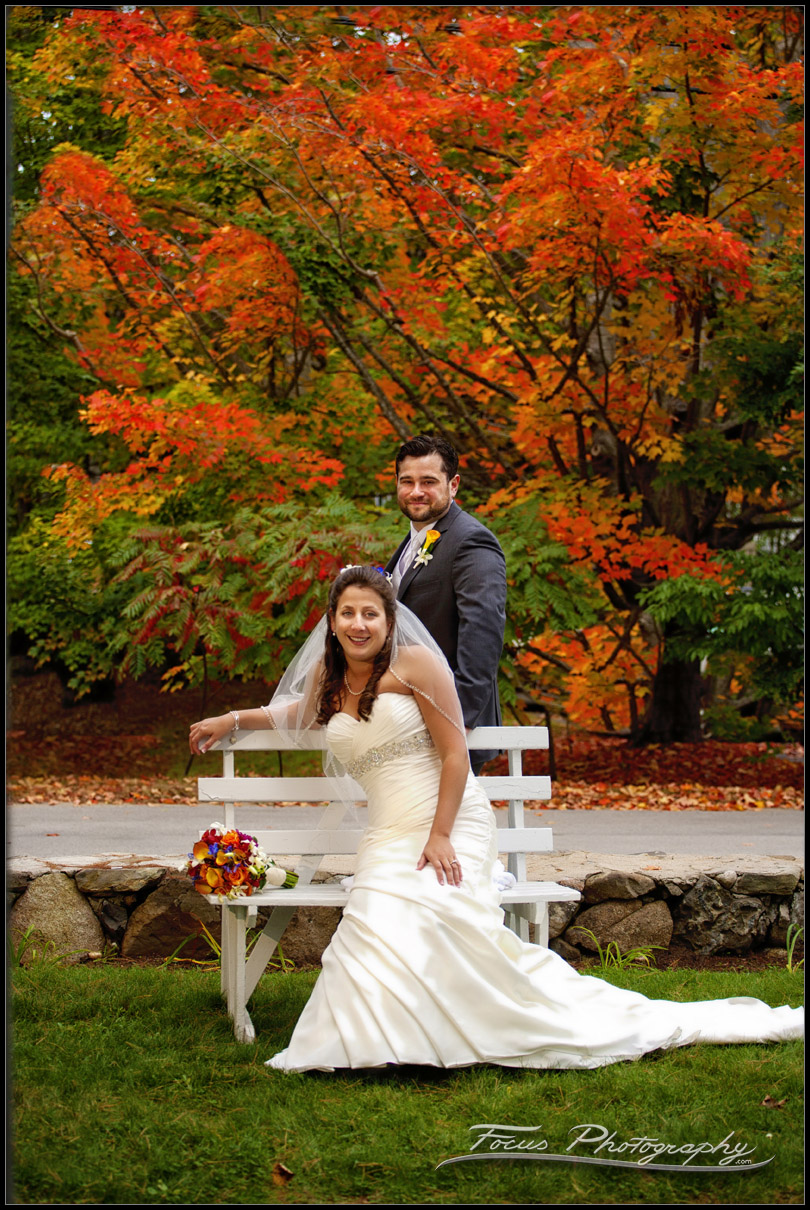 Wedding portraits at Colony Hotel in Maine with fall foliage