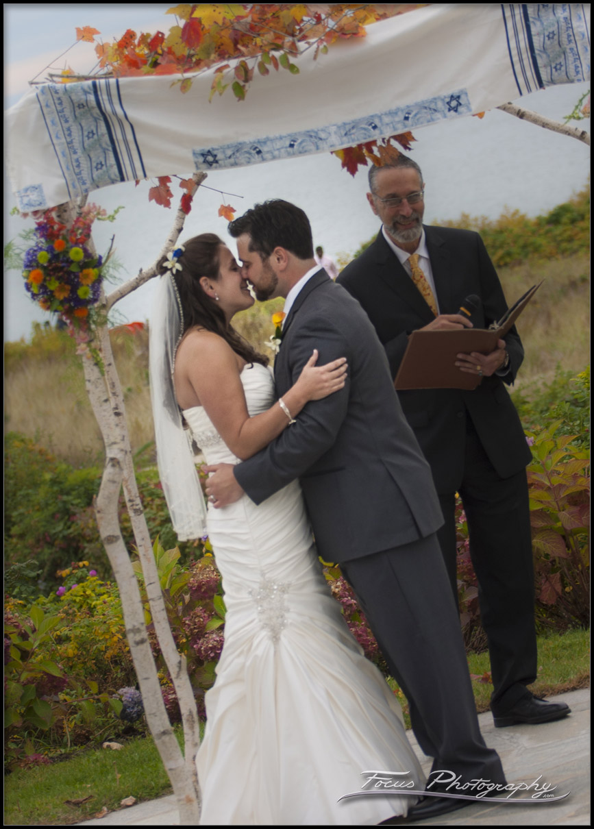 couple kiss at end of Wedding ceremony at  Colony Hotel in Kennebunkport, Maine