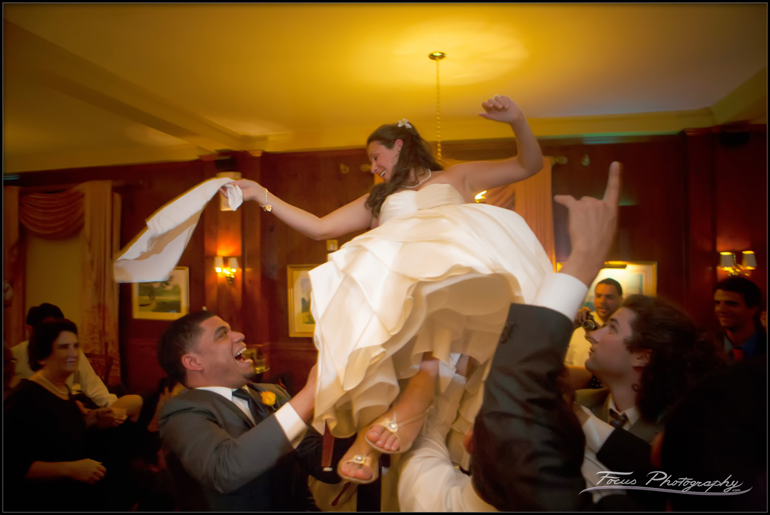 bride lifted during dance at wedding reception at Maine's Colony Hotel
