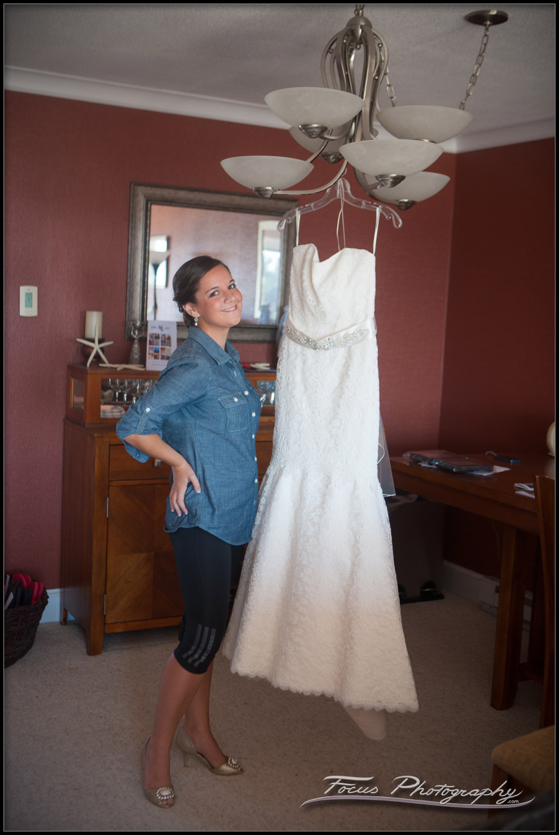 wedding gown hanging before wedding