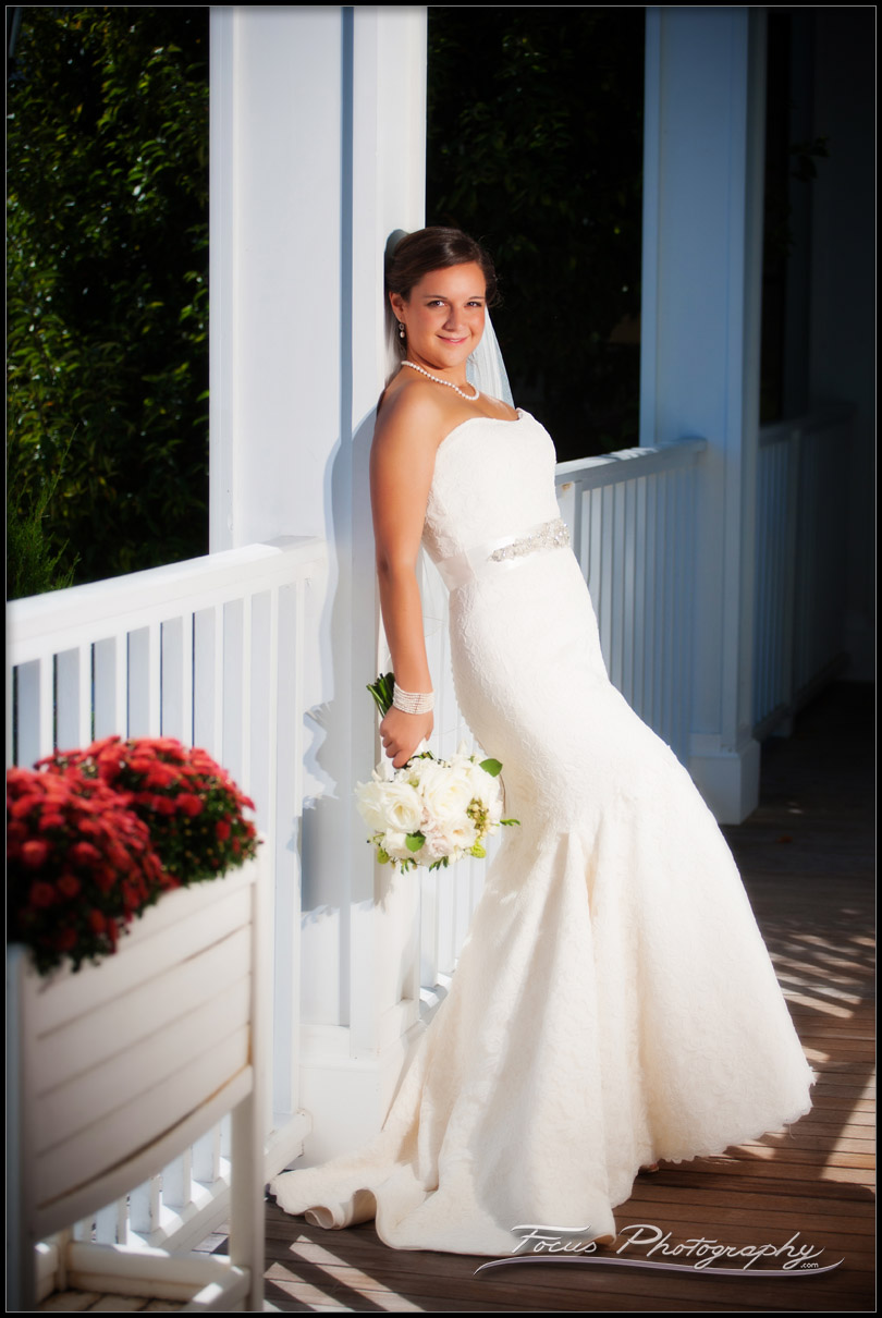 bridal portrait on porch at wentworth by sea in new castle, NH