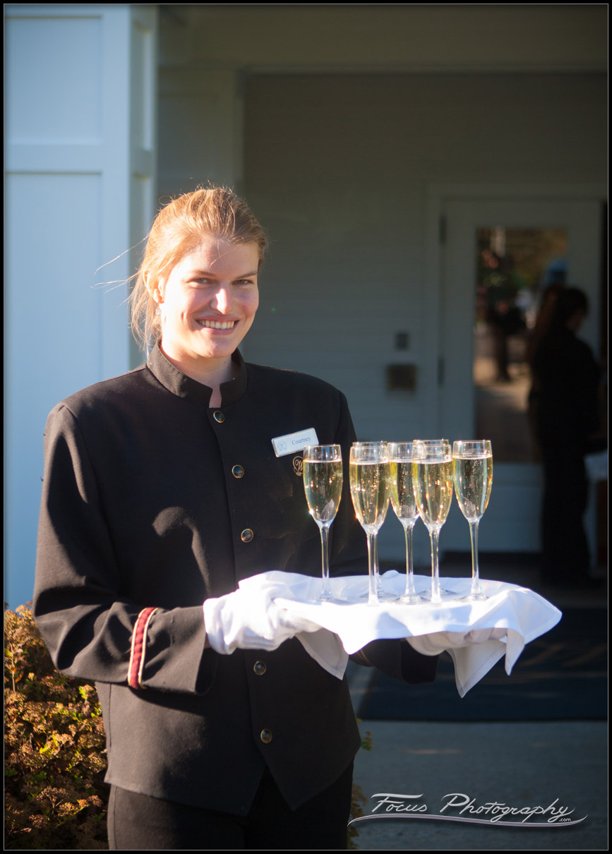 server holds champagne at wentworth by sea wedding