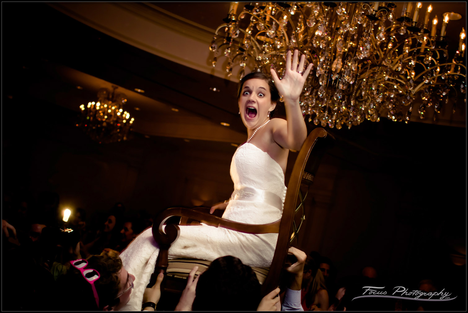 bride lifted in chair during wentworth wedding