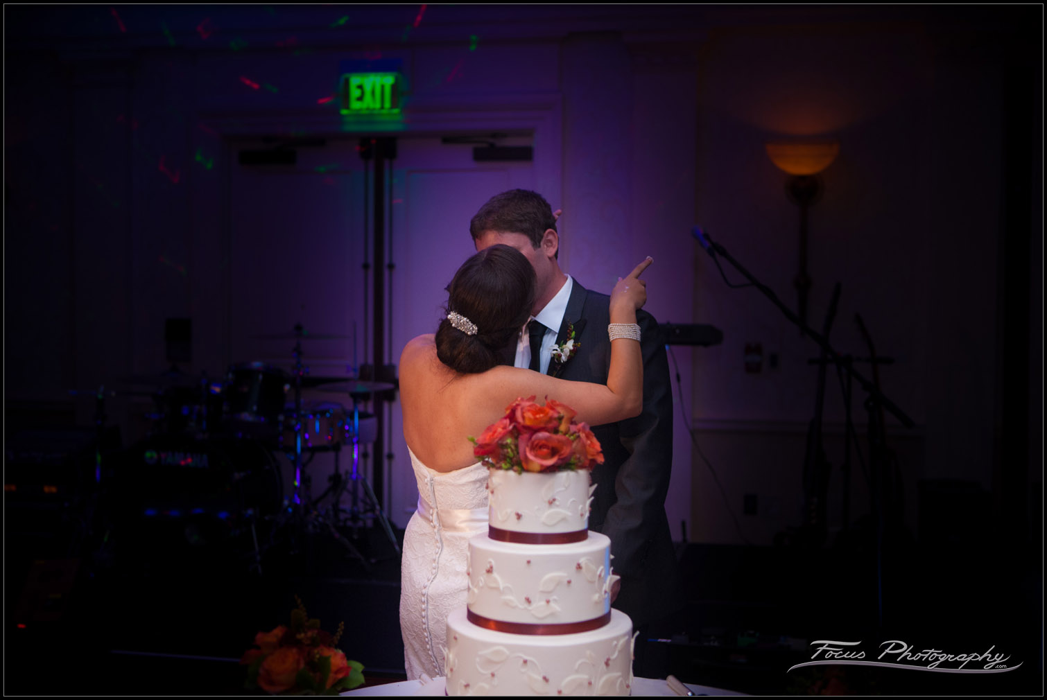 low light kiss in front of cake at wentworth by the sea