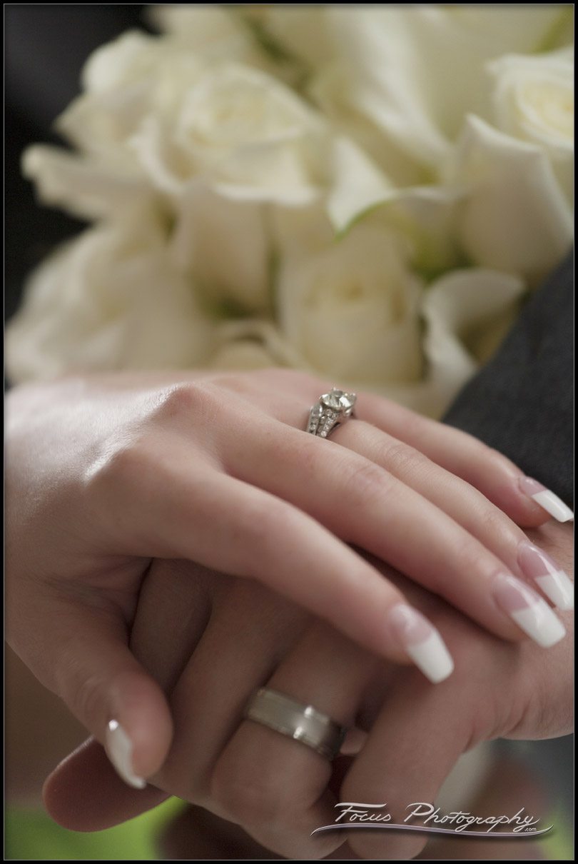 wedding rings on couple's hands