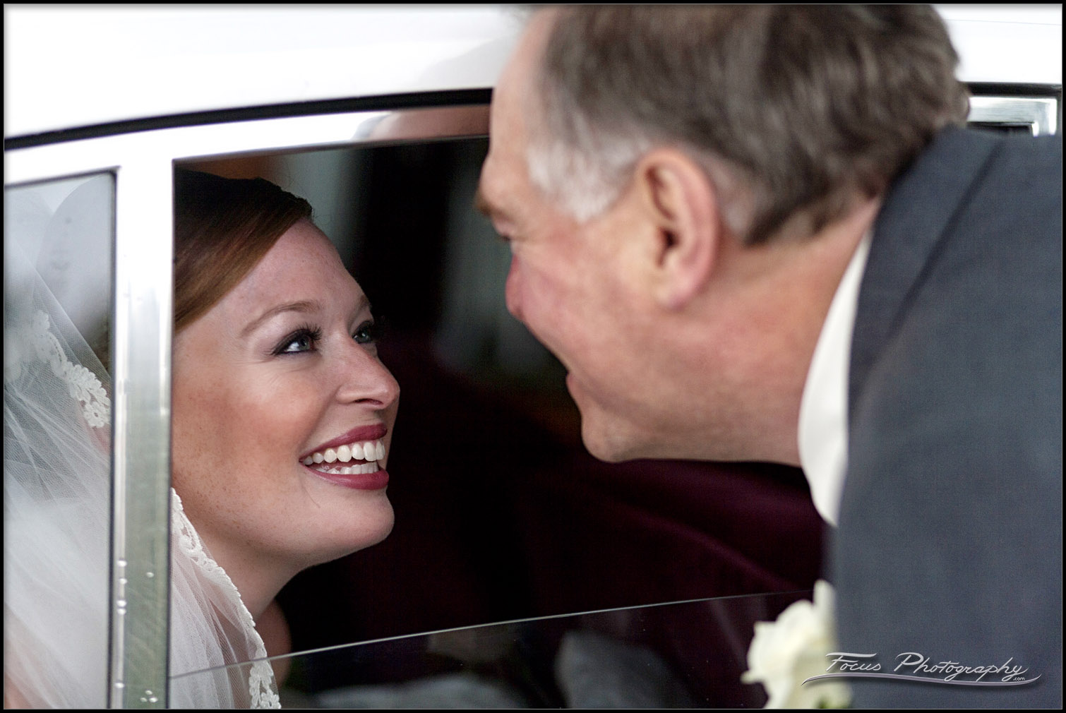 bride and father talking through window of limo