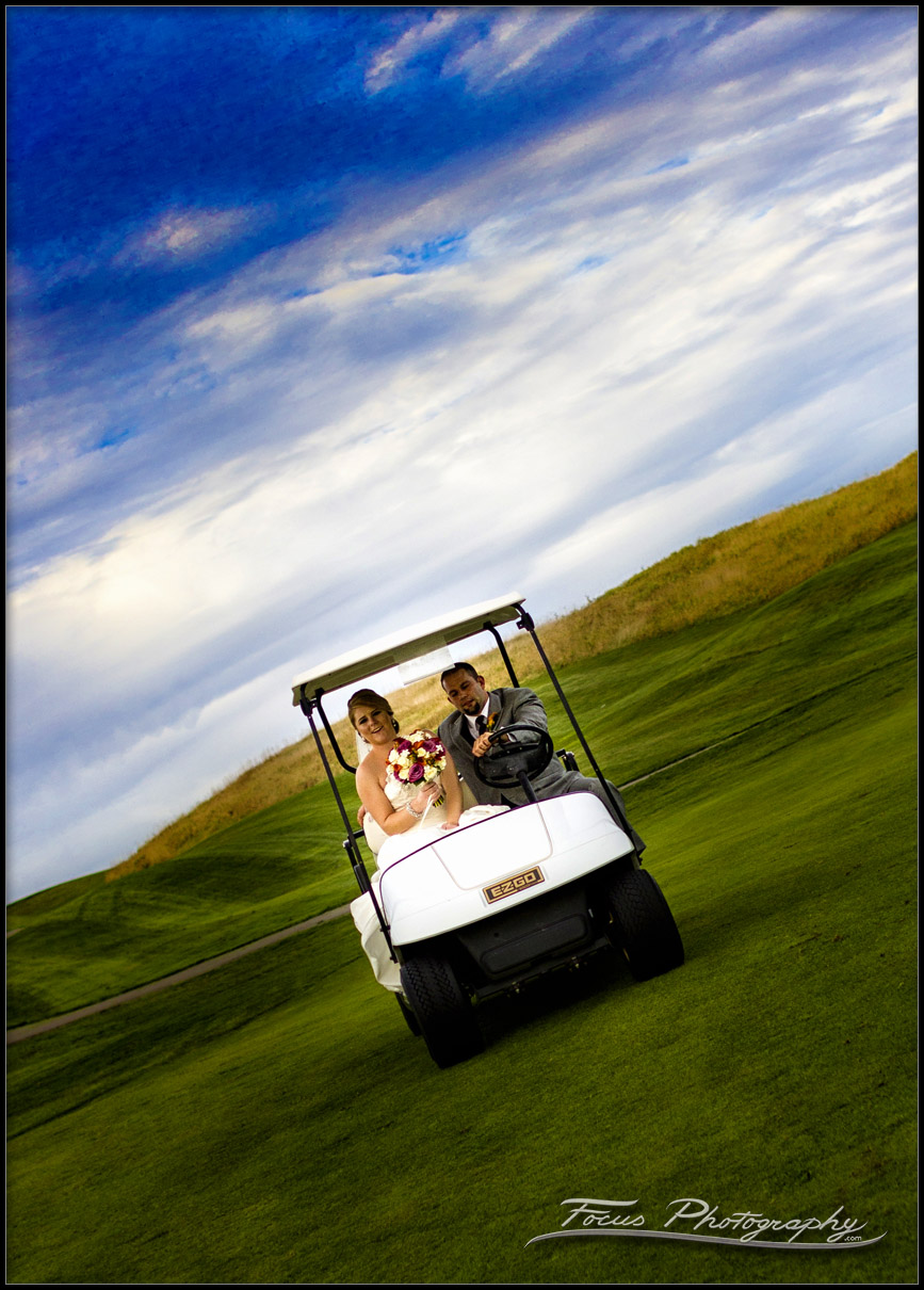 bride and groom in golf carts at Red Barn wedding
