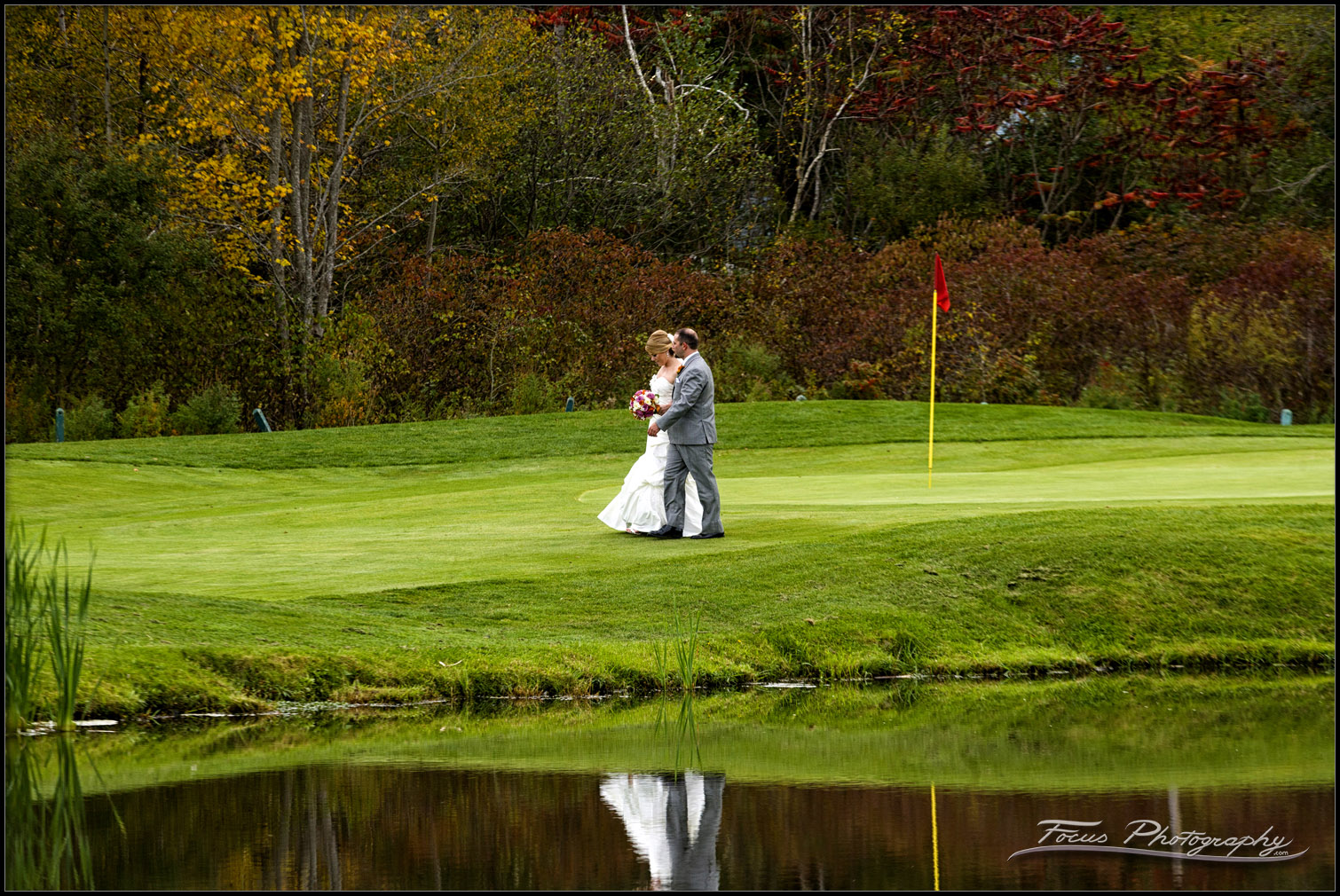 bride and groom on green at Red Barn wedding