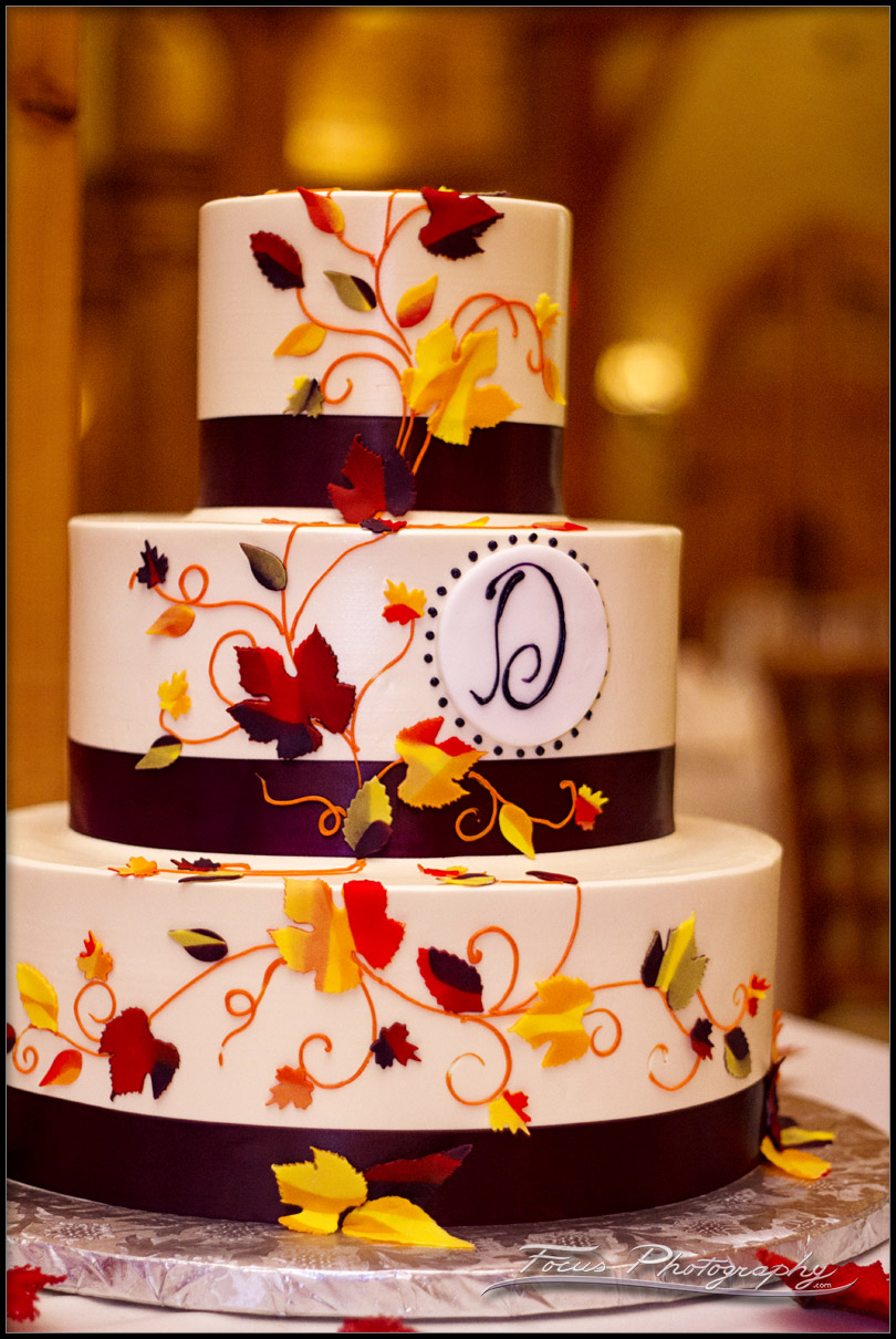 wedding cake with leaves for fall-themed wedding at red barn