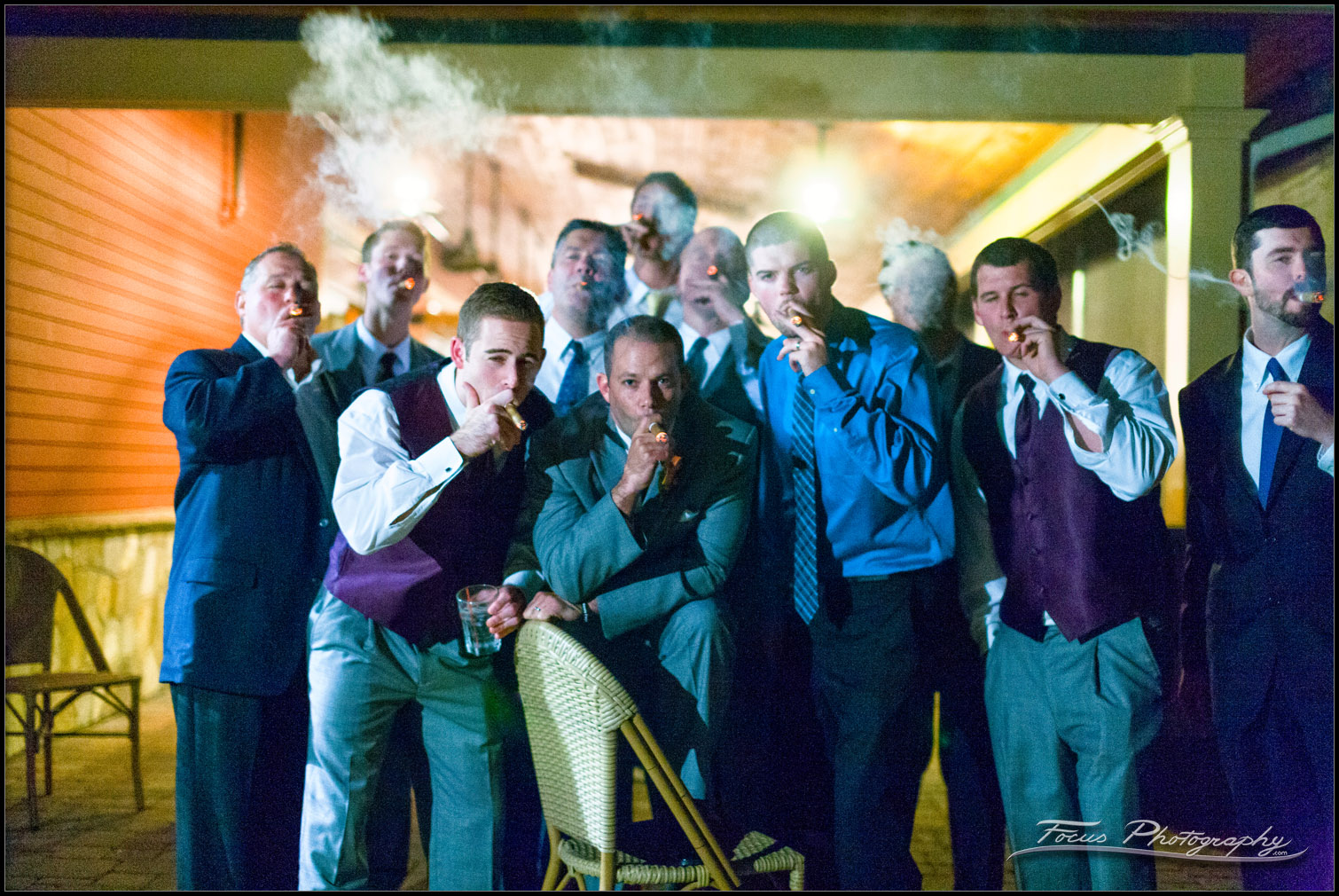 cigars being smoked outside red barn at end of wedding