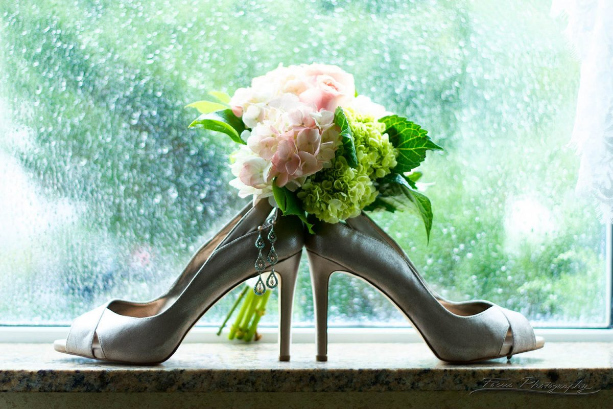 shoes and flowers at Freeport Hilton Garden Inn Wedding