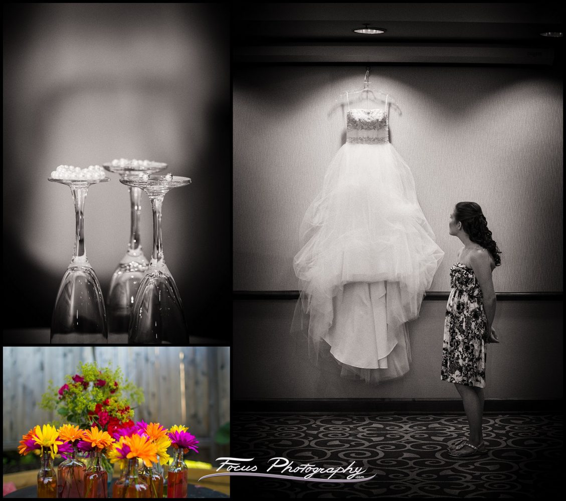The bride's dress hanging in the Clarion hotel in Portland, Maine wedding