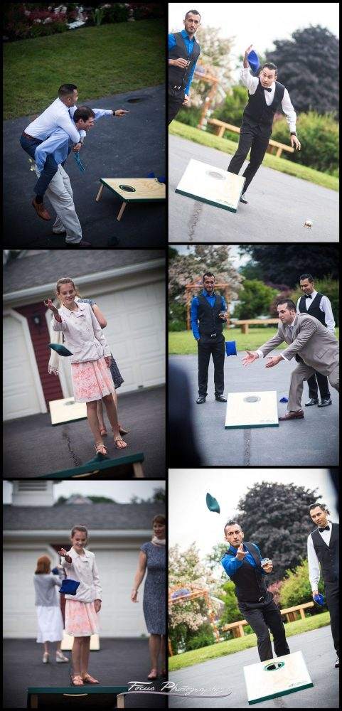 Wedding guests play cornhole during the cocktail hour