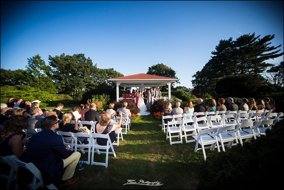 ceremony on back lawn at Wentworth by the Sea wedding in New Castle, NH
