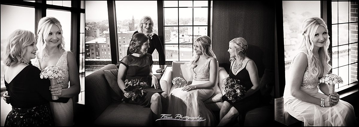 bride and friends at top of the east in Portland, Maine wedding