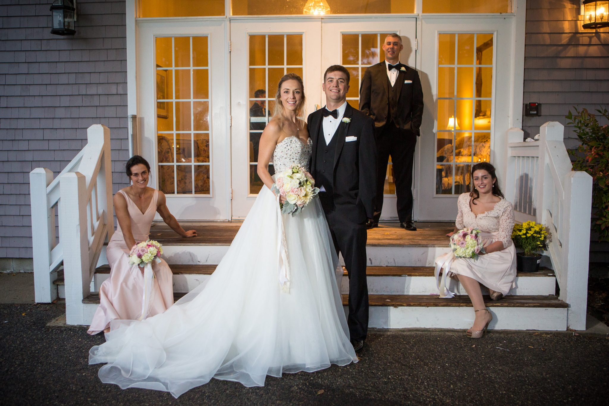 Wedding party on front steps of Dunegrass Golf Club
