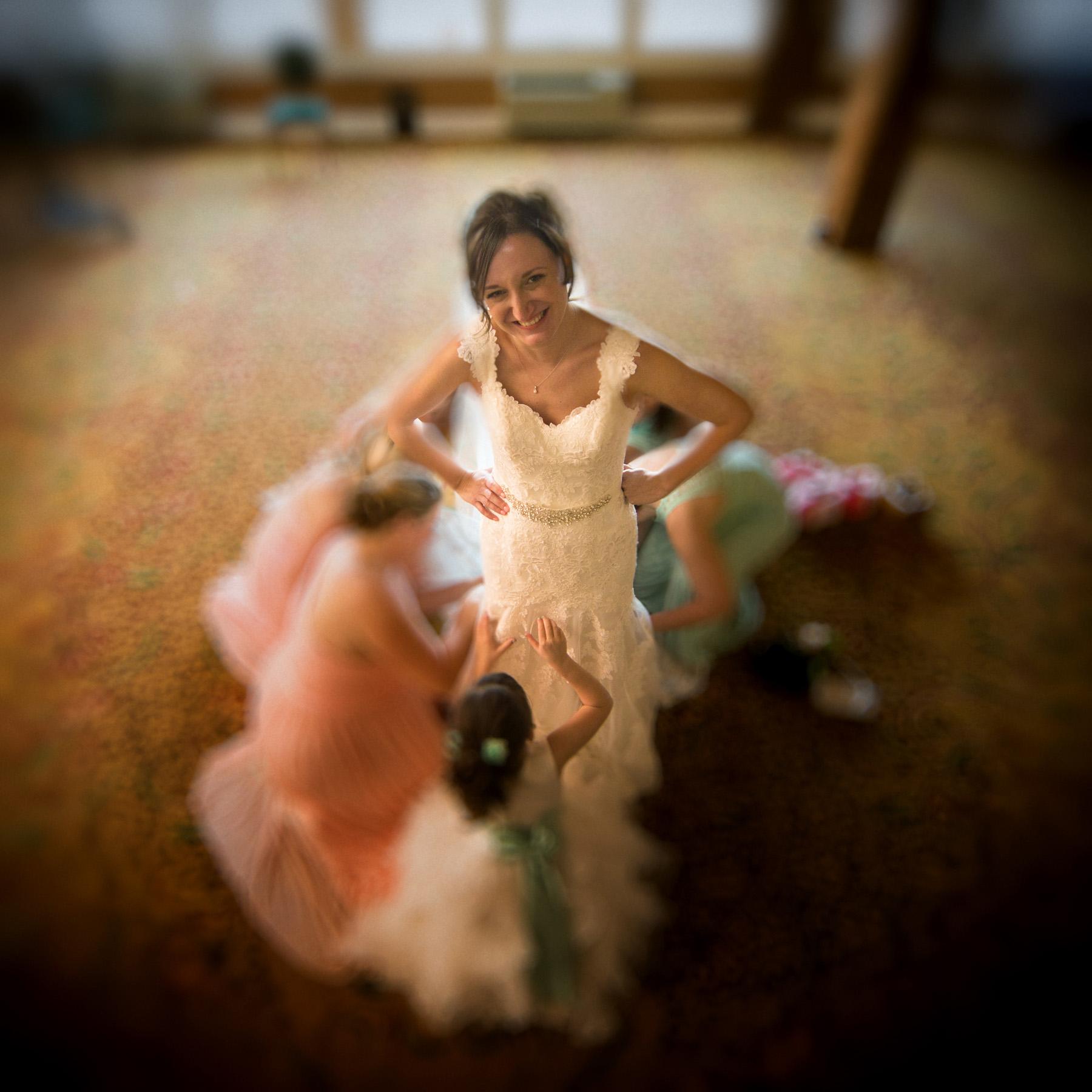 Bride getting her dress bustled at Samoset Resort wedding.
