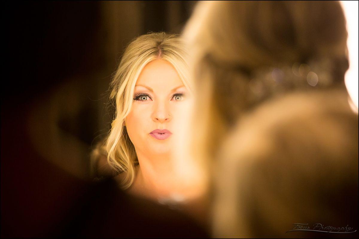 Westin Wedding bride getting ready in mirror