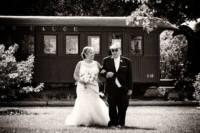 Father walks bride down aisle.