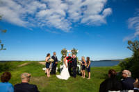Wedding party in front of Casco Bay