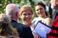 Bride laughs during wedding.
