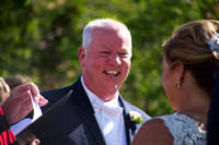 Groom laughs during ceremony