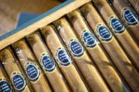 Cigars with custom labels for wedding gifts.