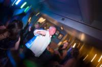 Groom on dance floor.