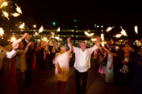 Bride and groom and sparkler exit at Casco Bay.