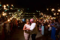 Bride and groom surrounded by guests with sparklers for a fiery exit from their wedding!