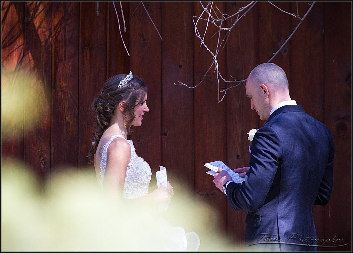 couple reading wedding vows