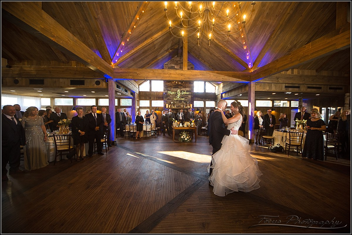 bride and groom dance at birch wood vineyard wedding