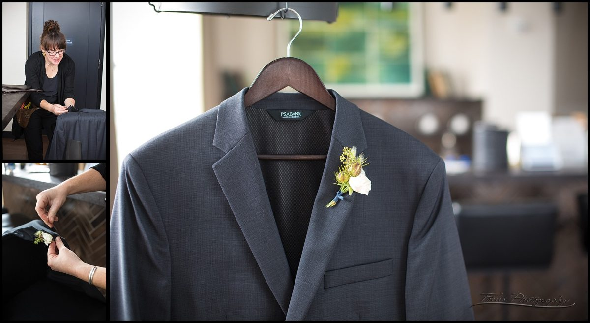 groom's suit coat and flowers