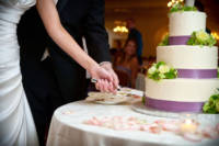 This is actually my all-time favorite cake-cutting picture.  We often frame the bride and groom this way - faces out of the shot, but hands on the knife together.  You see the action, you know the story, without looking the couple in the face.  But in this