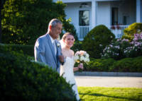 Dad walks bride down aisle on front lawn