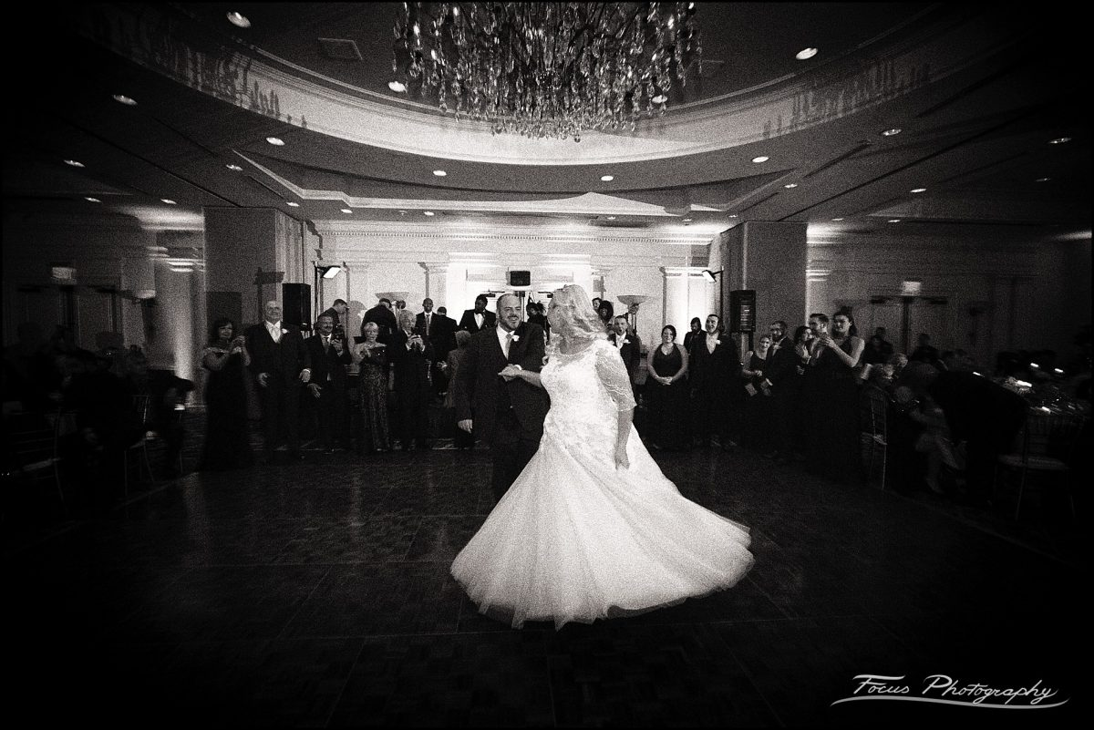 Bride spins while dancing at Wentworth by the Sea Wedding in New Castle, NH