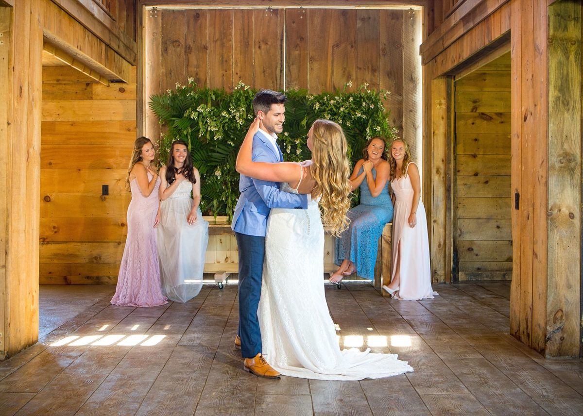 I love these bridesmaids for their enthusiasm for this first dance picture!