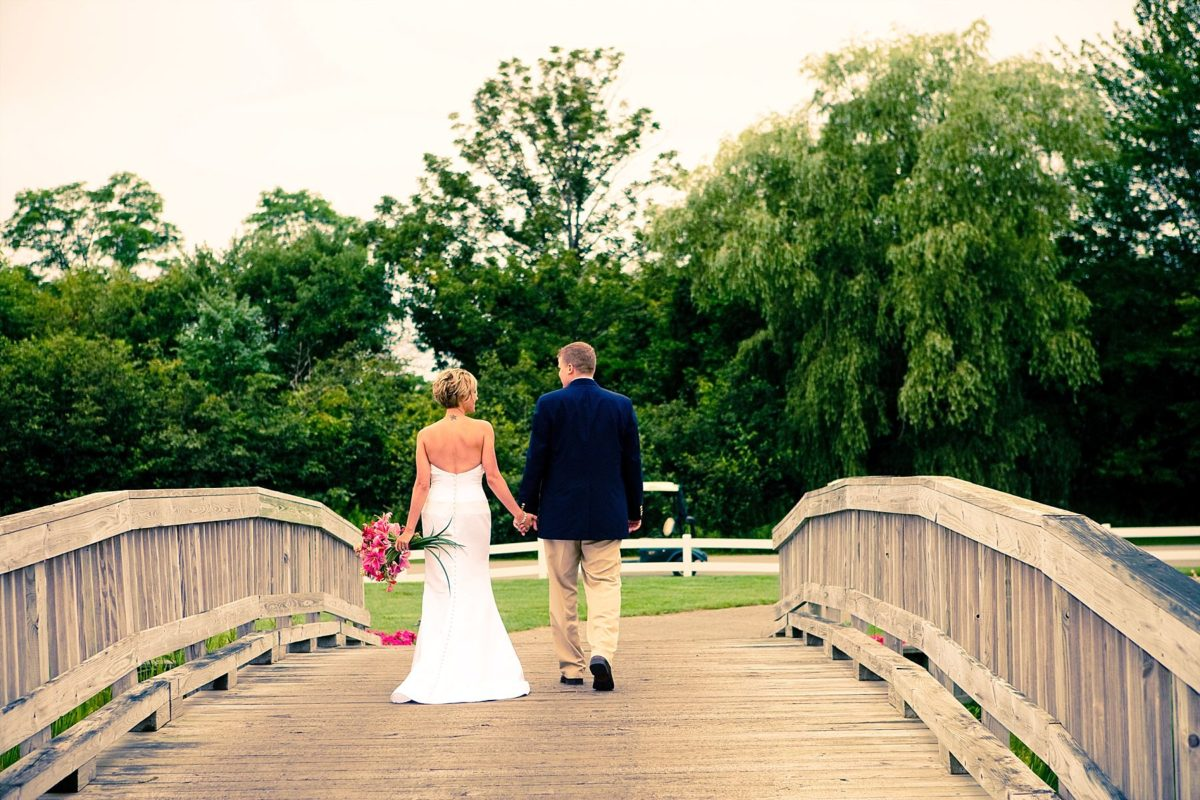 couple walking across bridge