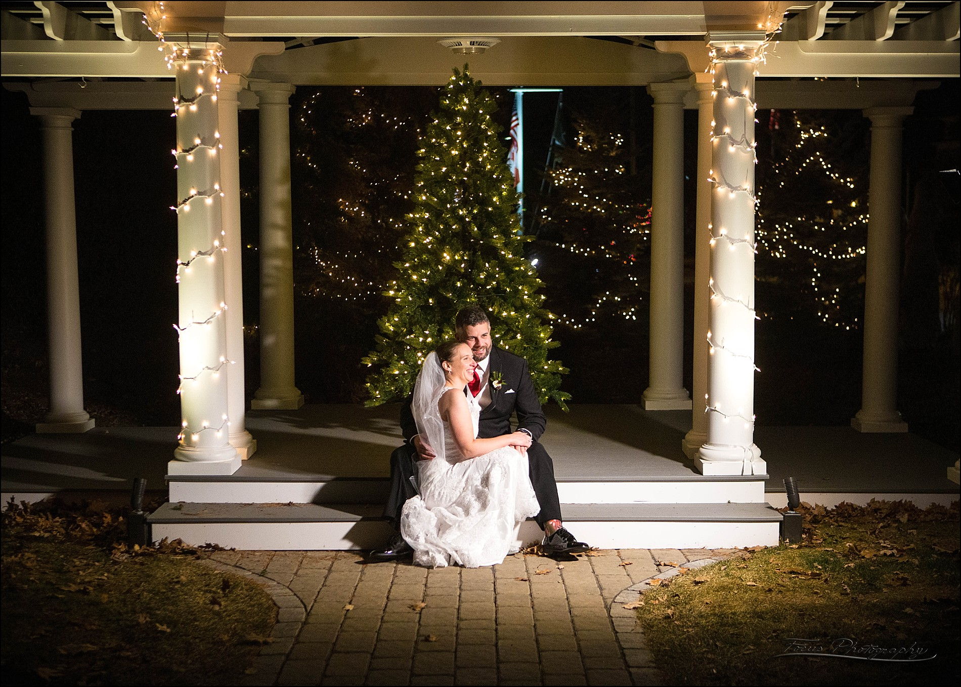 couple at Christmas tree at Village by the Sea wedding in Wells, Maine