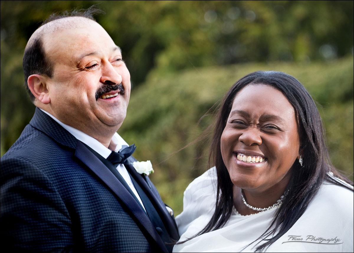 wedding couple laughs