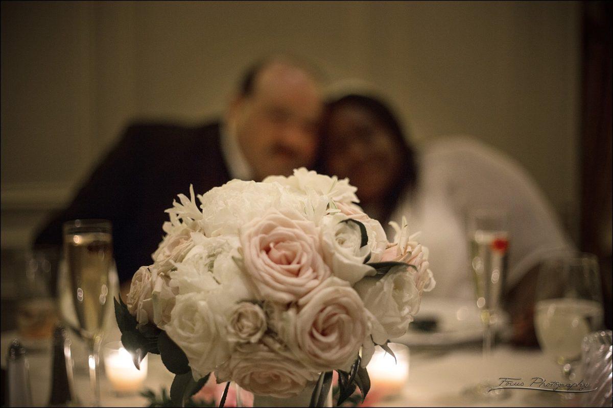 couple behind bouquet