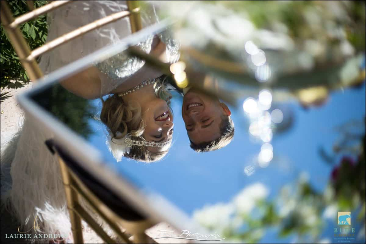 wedding couple reflected in table