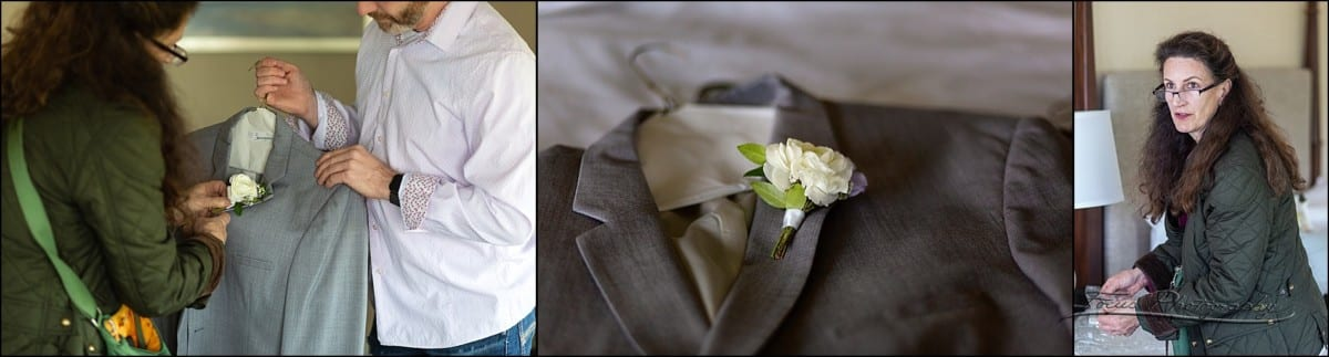 Florist pins flower on groom's lapel