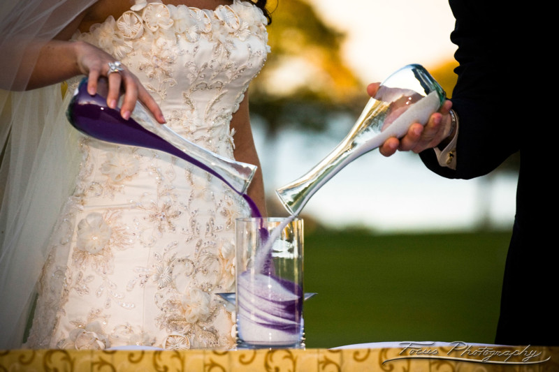 The sand ceremony symbolizes making something beautiful by combining two.