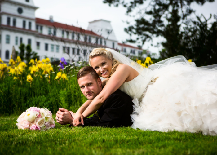 unconventional wedding portrait of couple laying on ground