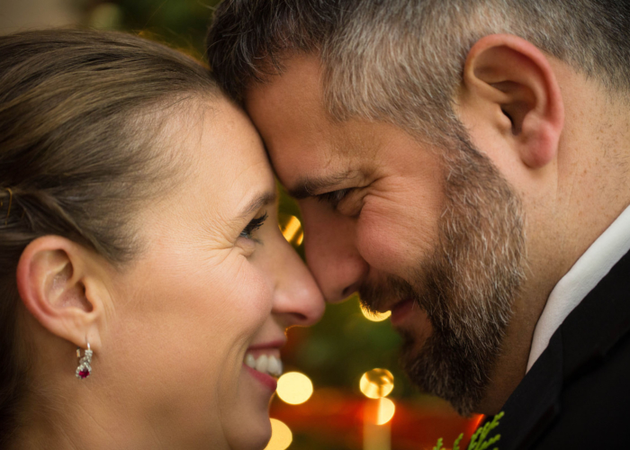 close up portrait of wedding couple nose to nose