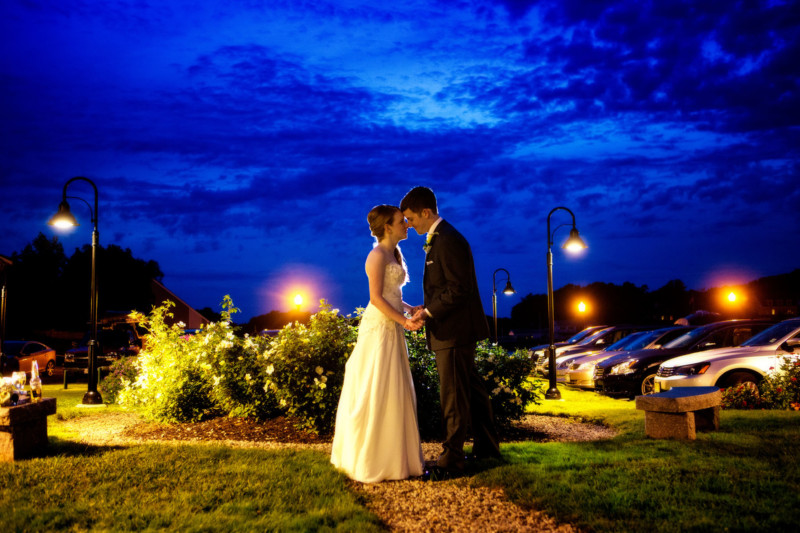 wedding couples' portraits of bride and groom at twilight