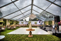 Glass tent at backyard wedding